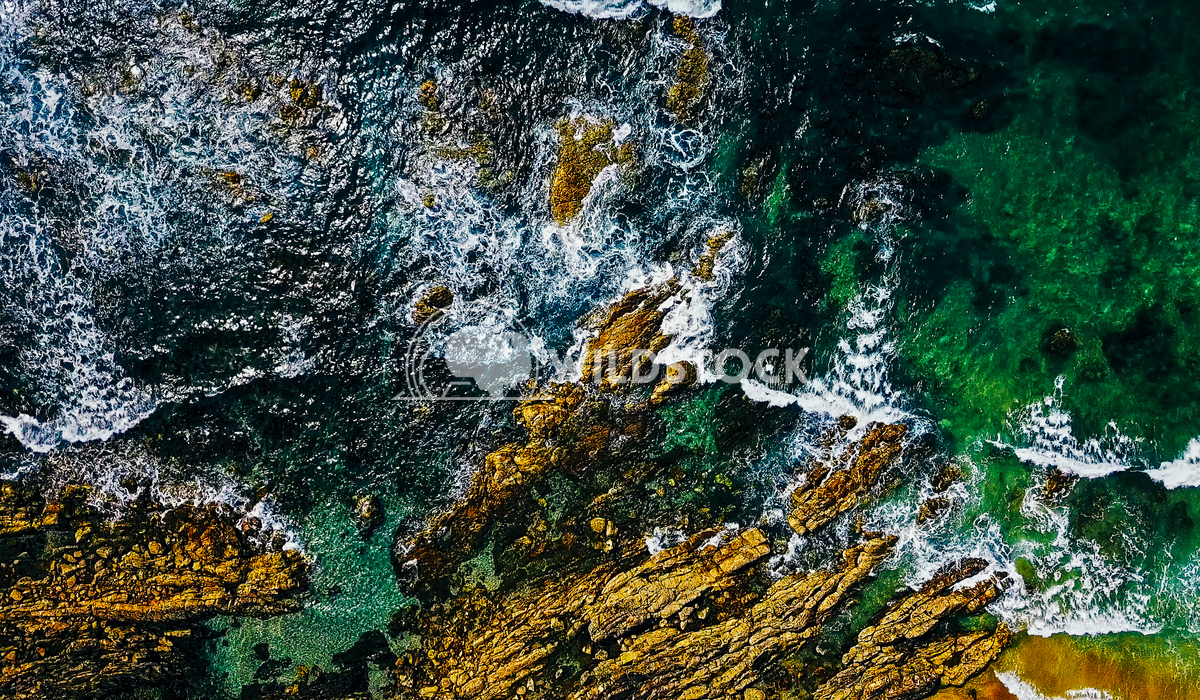 Aerial View From Flying Drone Of Ocean Waves Crushing On Rocky Beach Radu Bercan Aerial View From Flying Drone Of Ocean