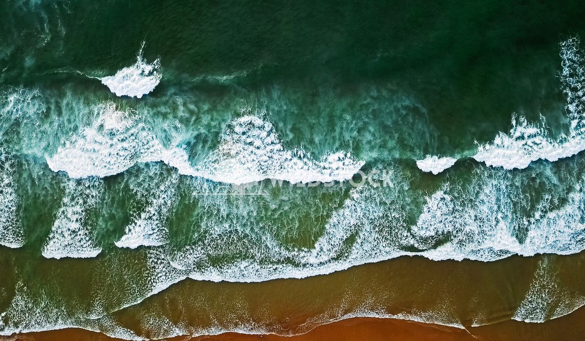 Aerial View From Flying Drone Of Ocean Waves Crushing On Beach Radu Bercan Aerial View From Flying Drone Of Ocean Waves