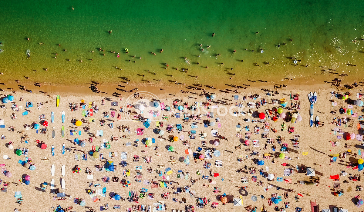 View From Flying Drone Of People Crowd Relaxing On Beach In Portugal Radu Bercan Aerial View From Flying Drone Of People