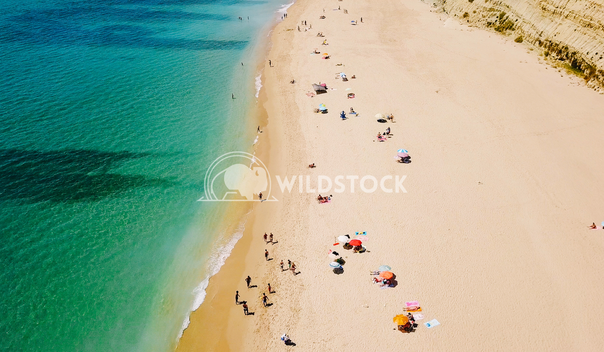 Aerial View Of Flying Drone Of People Crowd Relaxing On Beach In Portugal Radu Bercan Aerial View From Flying Drone Of P