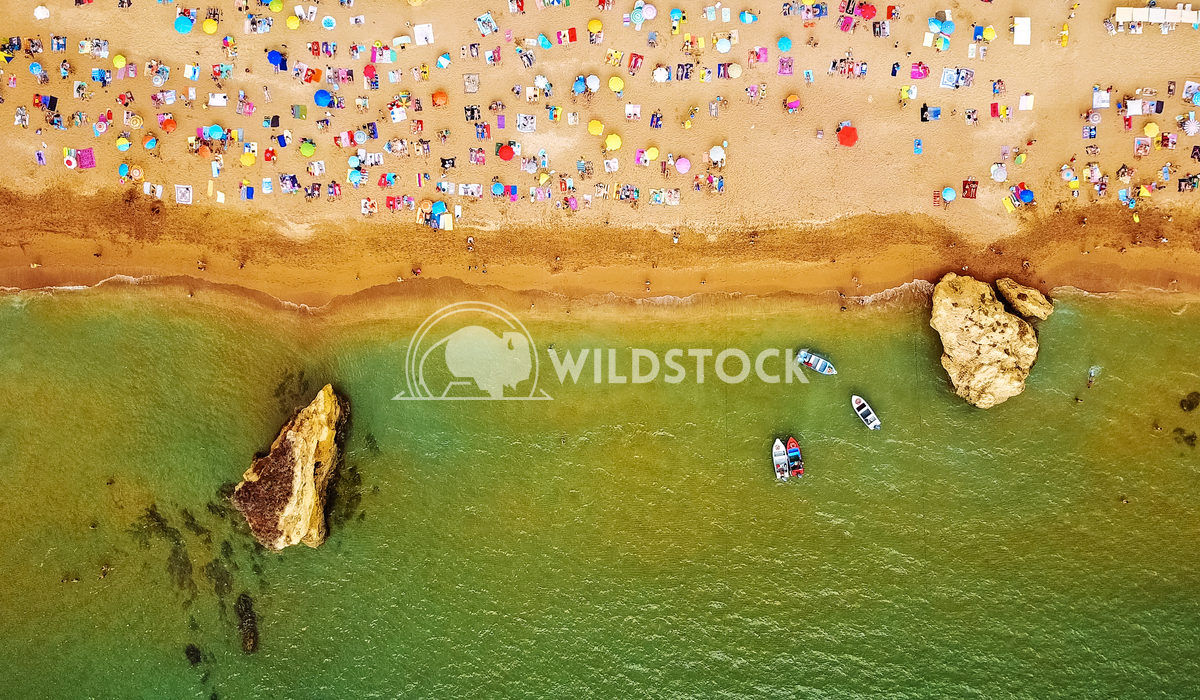 Aerial Summer Top View From Flying Drone Of People Crowd Having Fun On Beach In Portugal Radu Bercan Aerial Summer Top V