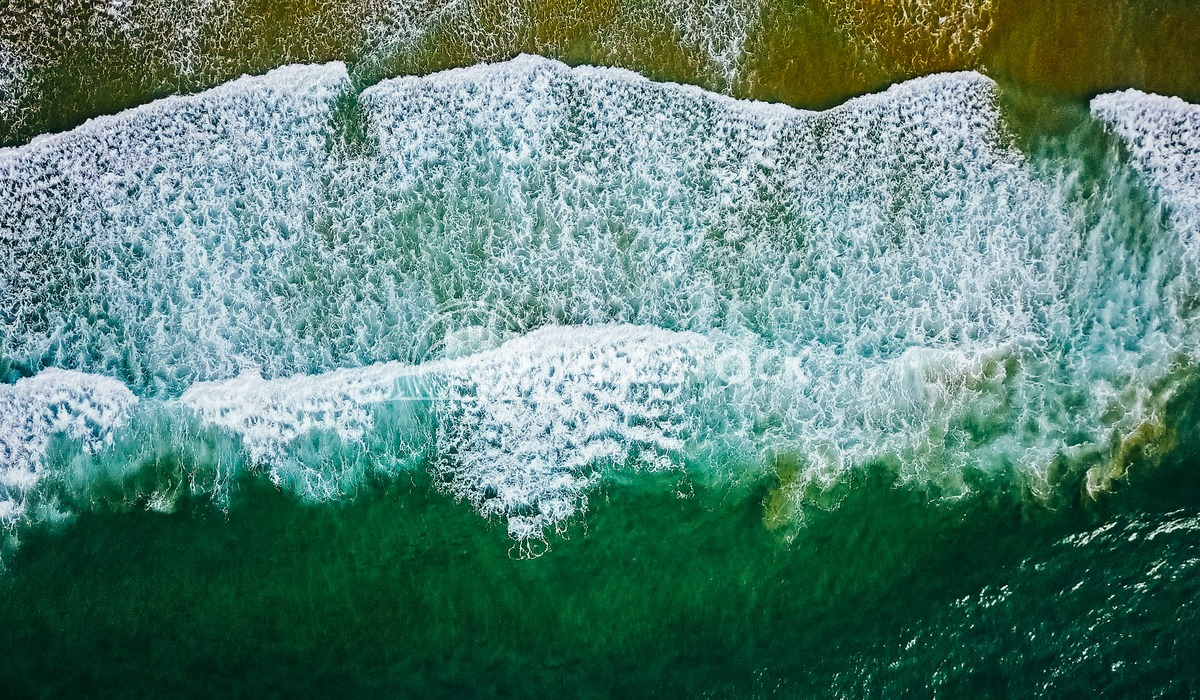 Aerial View Of Ocean Waves On Beach Radu Bercan Aerial View From Flying Drone Of Ocean Waves Crushing On Beach
