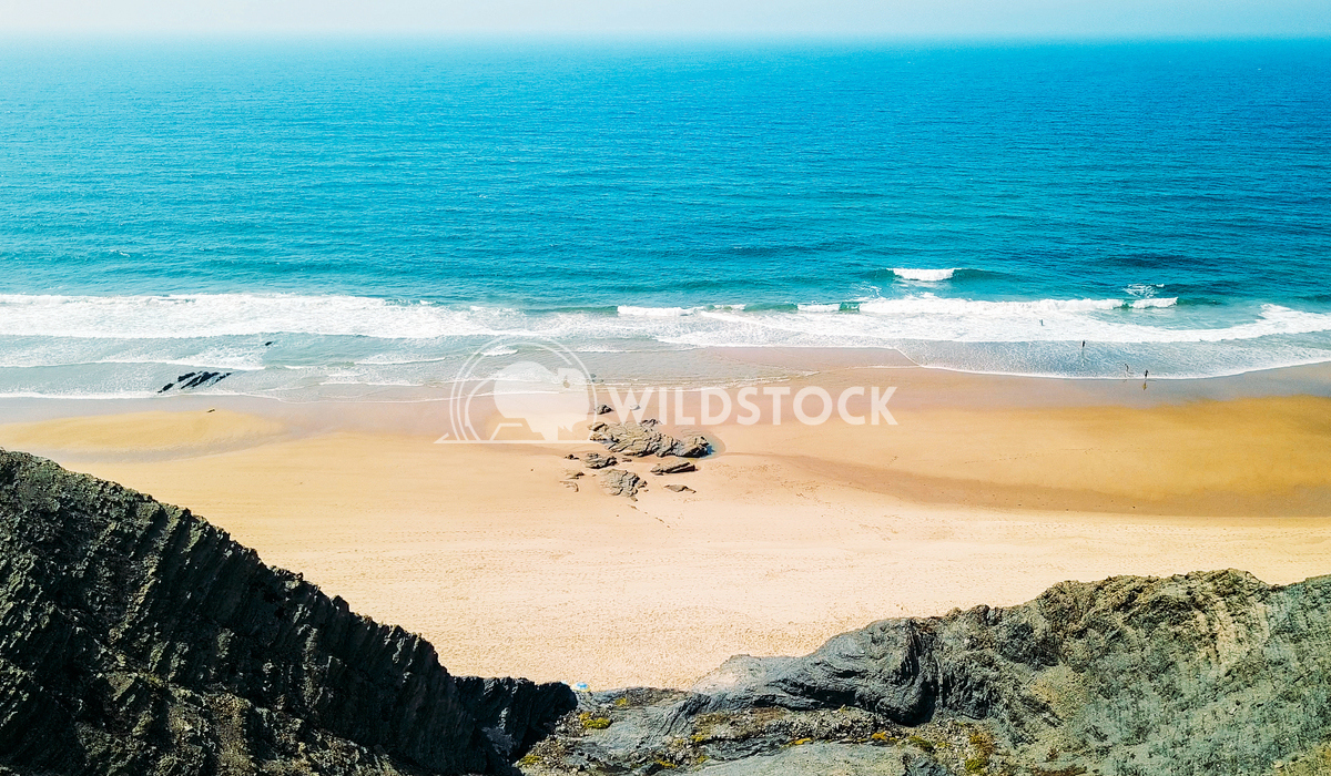 Aerial Panoramic Drone View Of Blue Ocean Waves And Beautiful Sandy Beach in Portugal Radu Bercan Aerial Panoramic Drone