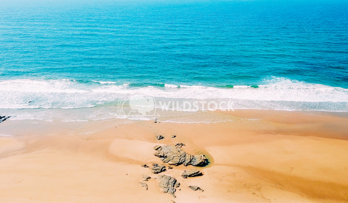Aerial Drone View Of Blue Ocean Waves And Beautiful Sandy Beach in Portugal Radu Bercan Aerial Panoramic Drone View Of B
