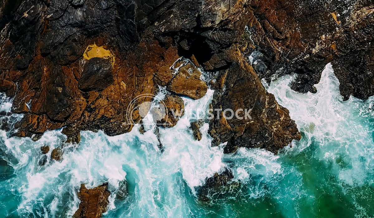 Aerial View Of Dramatic Ocean Waves Crushing On Rocky Landscape Radu Bercan Aerial Drone View Of Dramatic Ocean Waves Cr