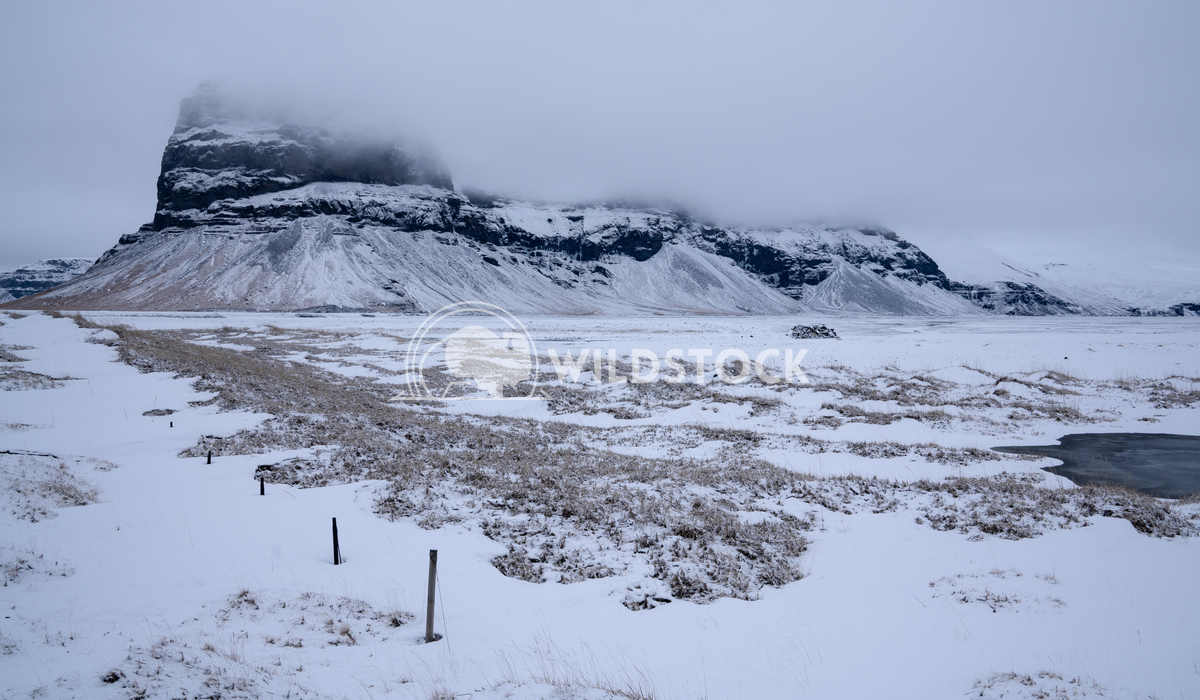 Lomagnupur, Iceland 1 Alexander Ludwig Panoramic landscape along the southern coast of Iceland with snow-covered mountai