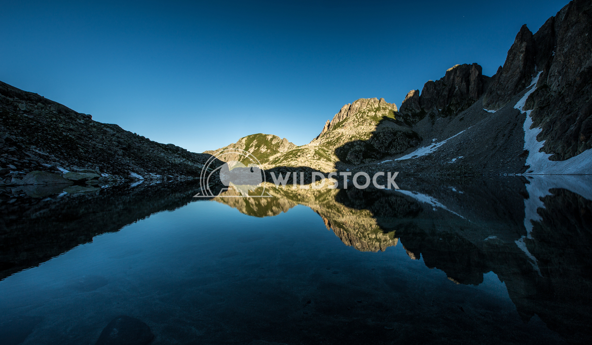 Blue Reflections Vincentiu Solomon Perfect symmetry reflection of a lake in the mountains.