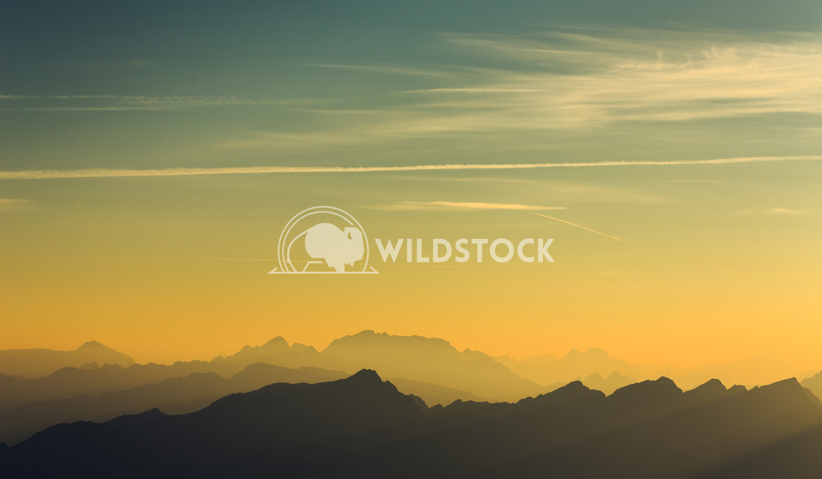 Silhouette mountains and passing clouds Vincentiu Solomon Silhouette of a mountain range in the Italian Alps.