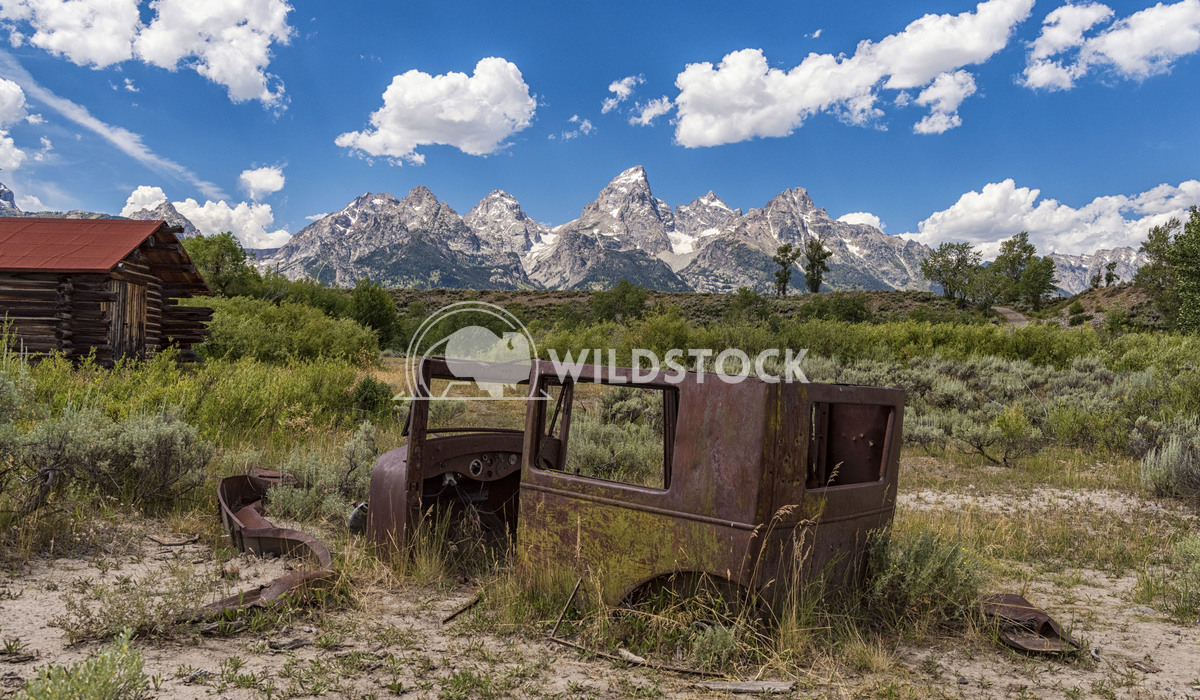 Rusty Car and Tetons Stacy White Remnants of an old vehicle at an abandoned dude ranch in Grand Teton National Park